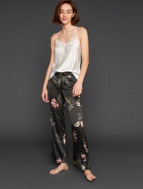 Satynowe spodnie w deseń kwiatowy z szerokimi nogawkami kaki.