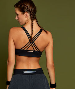 Sportowy biustonosz w średnim stopniu trzymający biust czarny.