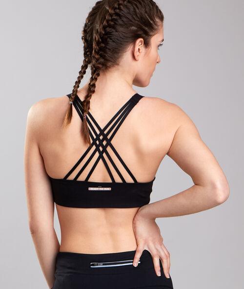 Sportowy biustonosz w średnim stopniu trzymający biust