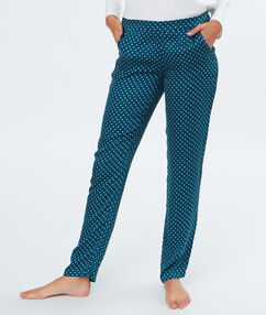 Pantalon à pois bleu.