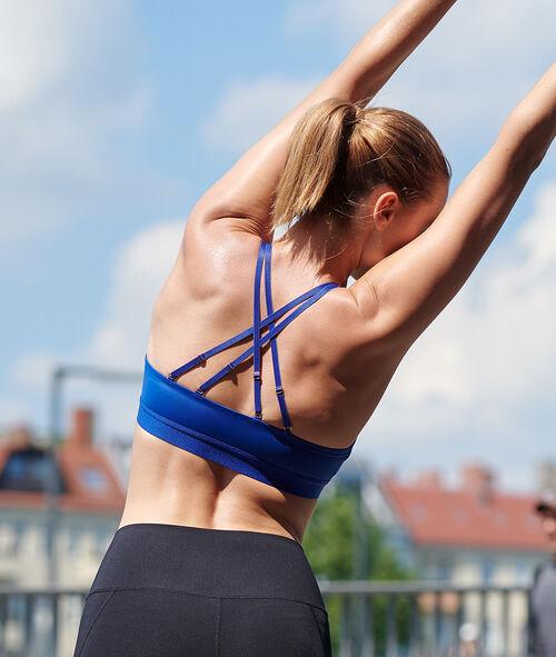 Biustonosz sportowy z ramiączkami skrzyżowanymi na plecach - lekkie podtrzymanie